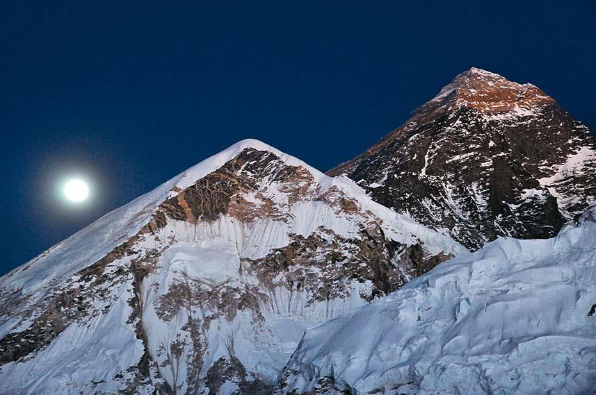 As we descended from Kala Patthar after sunset, the moon rose behind the west shoulder of Everest and we found Gorak Shep illuminated by moonlight