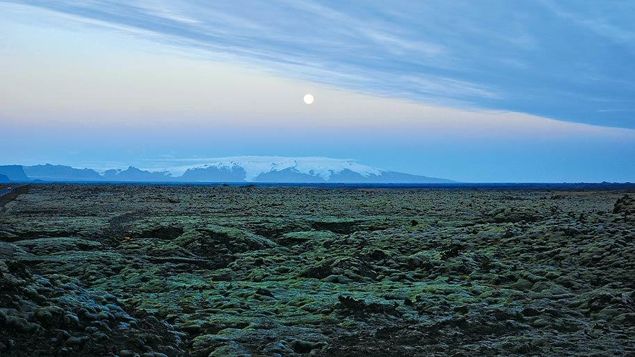 The benign-looking lava fields at Eldhraun were created when an almost simultaneous eruption of over 135 craters in the 18th century at nearby Laki led to death, destruction and the formation of over 500 sq km of lava fields. On the horizon is the glacier Myrdalsjokull, beneath which lies the active volcano Katla