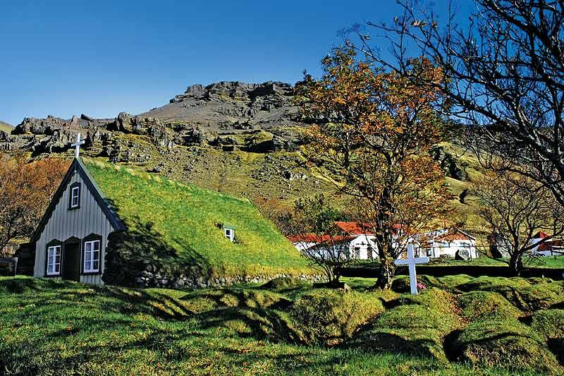 Turf-roofed wooden church at Hof, Oraefi is a classic example of traditional Icelandic architecture and is one of the few surviving buildings in the style