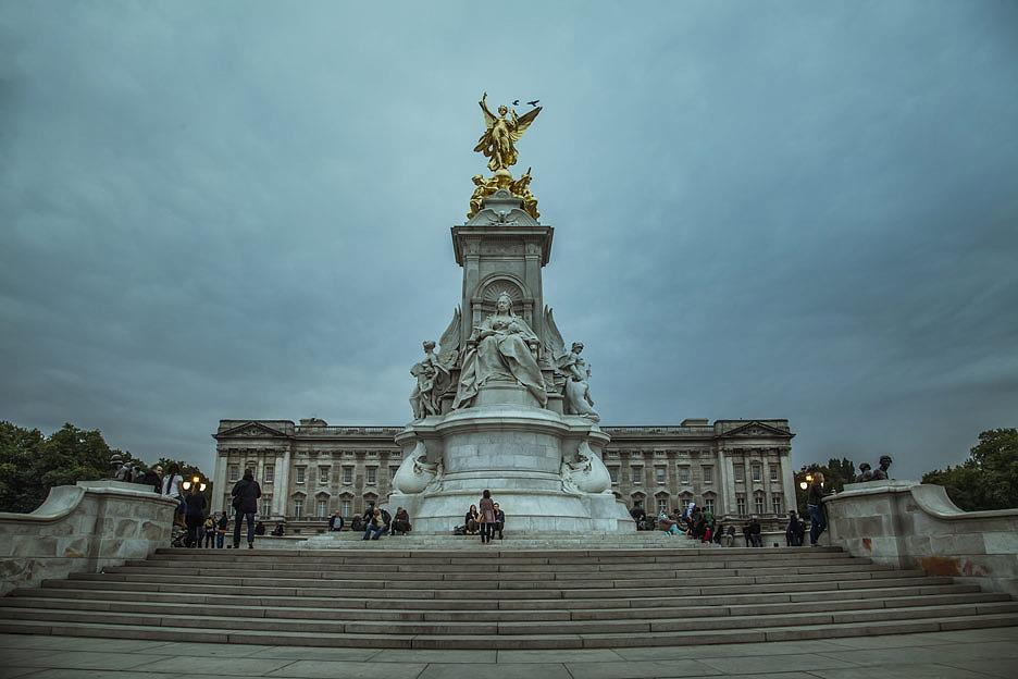 Victoria Memorial, the statue of Queen Victoria, in front of the Buckingham Palace. The statue is placed at the centre of the space known as Queen's Gardens.