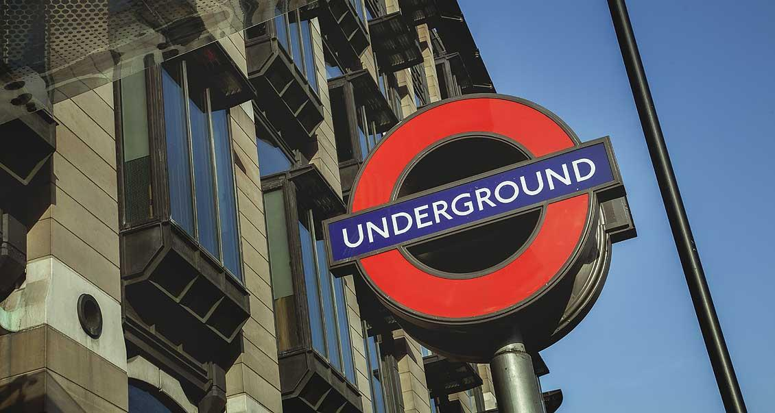 A London underground entrance sign. The iconic design and the 'Mind the Gap' announcement made for passengers on the tube trains feature in typical souvenirs like T-shirts and fridge magnets.
