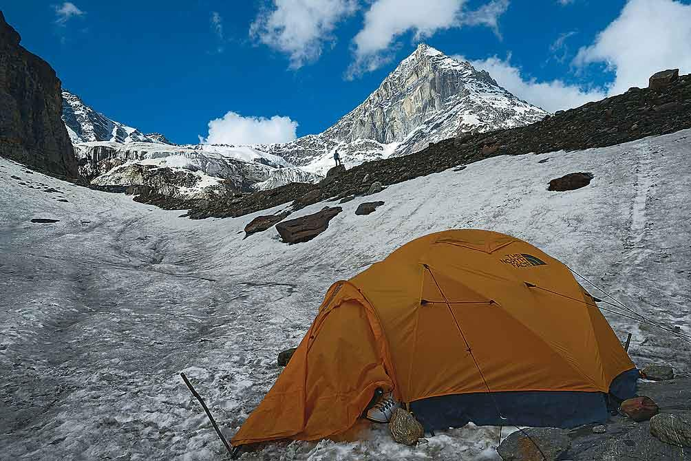 A seasonal snowfield at the base of the Panpatia icefall offers glorious views of Neelkanth and other higher peaks to those who are willing to trudge up the ridge behind it. During our stay there, we alternated between taking in the views and worrying about the underground streams that were chewing through the snow throughout the day.