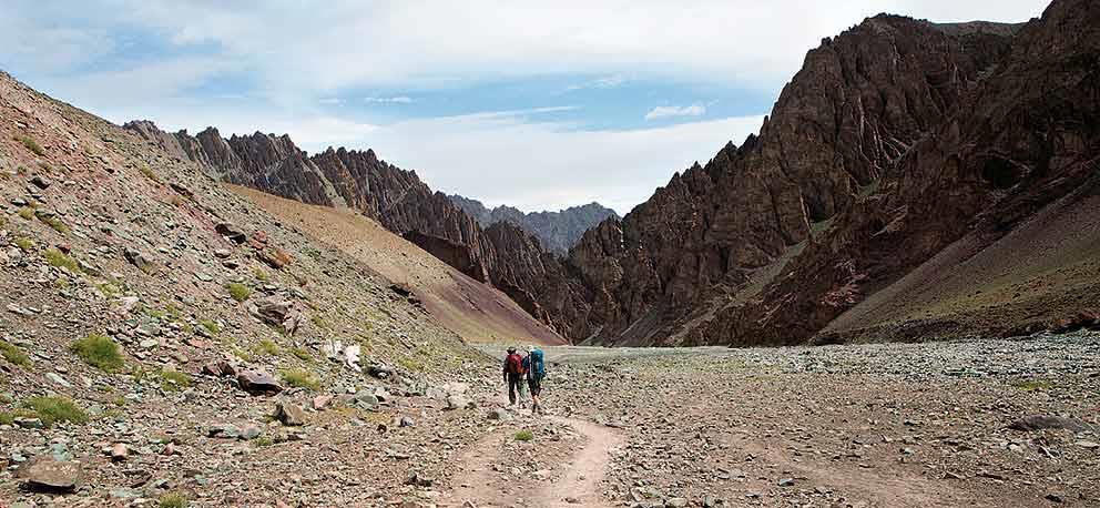 Trekkers make their way down to Stok village from Mankarmo along the Stok Chu valley