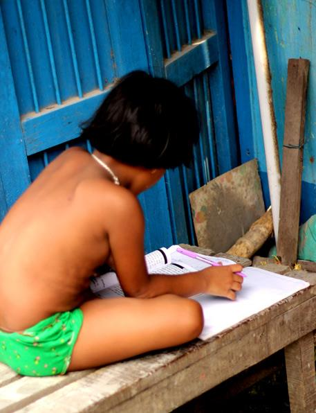 Before the much anticipated 'pujor chhuti' (puja holidays) comes the dreaded school exams. So while the elders are busy making idols, this little girl has no time to gape at them (idols).