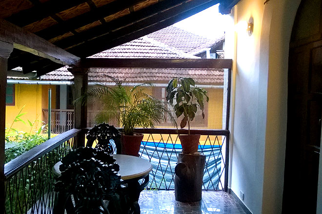 A balcony at one of the houses in Fontainhas. The ceiling done in straw, the elaborately carved wooden furniture and the clay tiled roofs also reflect a more eco-friendly form of luxury