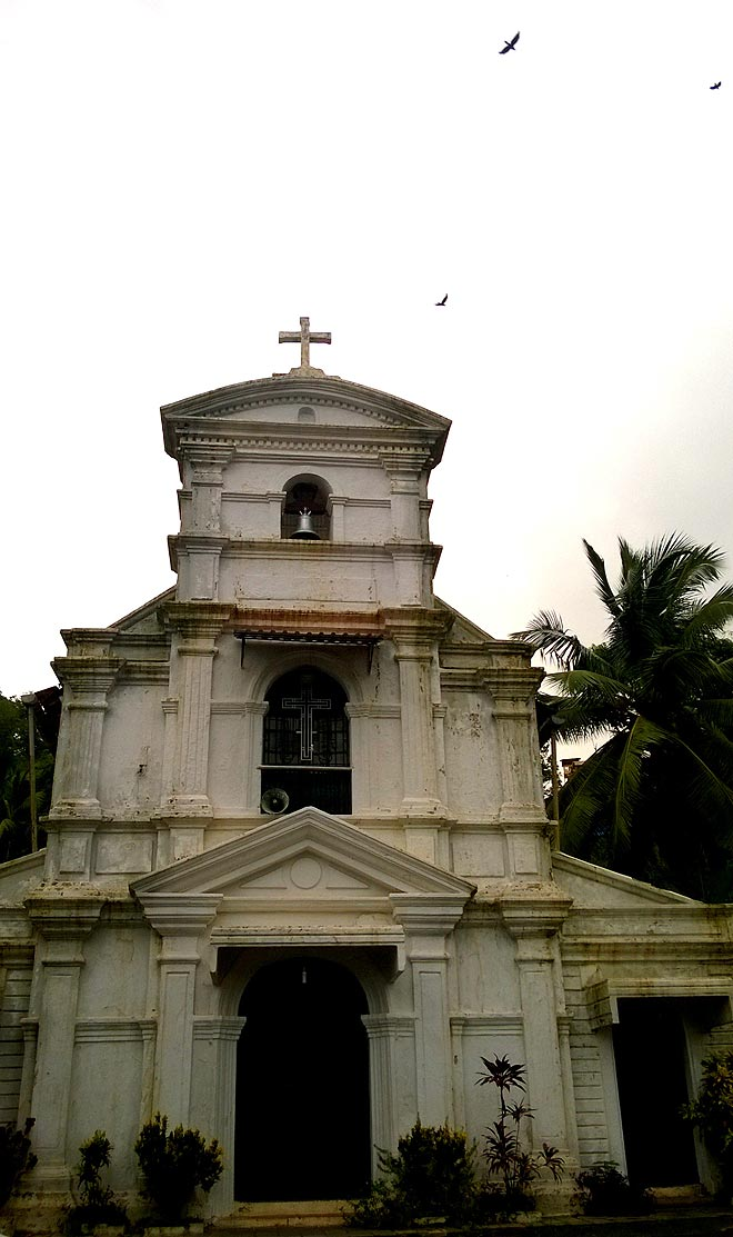 Amidst the frenzy of bright and bold colours of Fontainhas, right at the centre,  stands this  pretty little church, pristine and white, The Chapel of St. Sebastian which was built in 1818