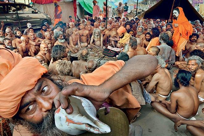 Naga sadhus of Juna Akhara attend a ceremony at the Mahakumbh in 2013