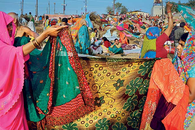 A riot of colours on the saris worn by women pilgrims at the kumbh, full of beautiful floral and traditional patterns