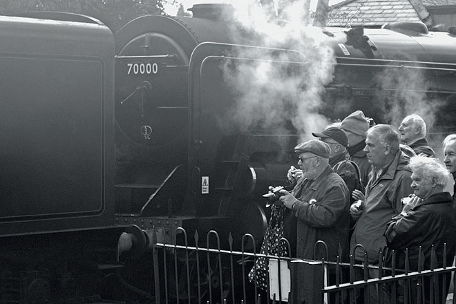 Steam enthusiasts admire an old beauty at Alresford in Hampshire
