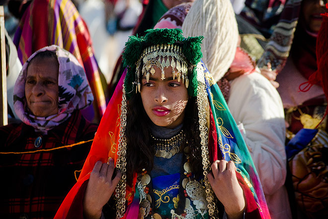 Traditionally-attired Bedouin women watch the men compete