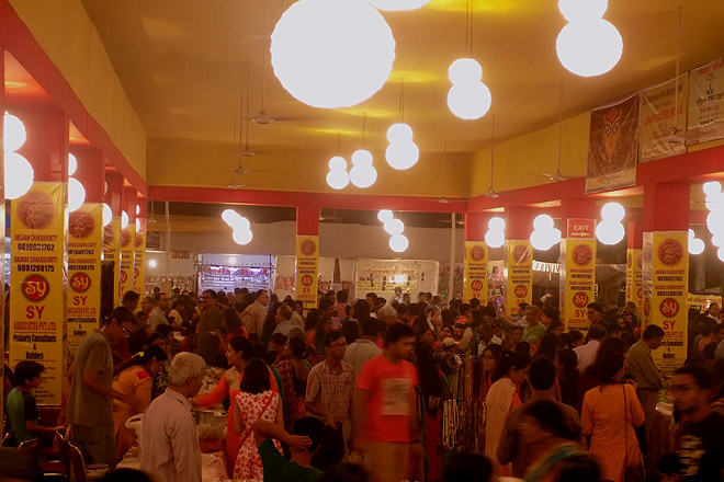 Visitors at the numerous food and craft stalls set up by local residents inside the pandal