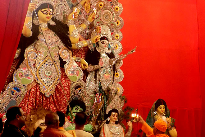 The evening Aarti being performed at the pandal near Kalibari in CR Park