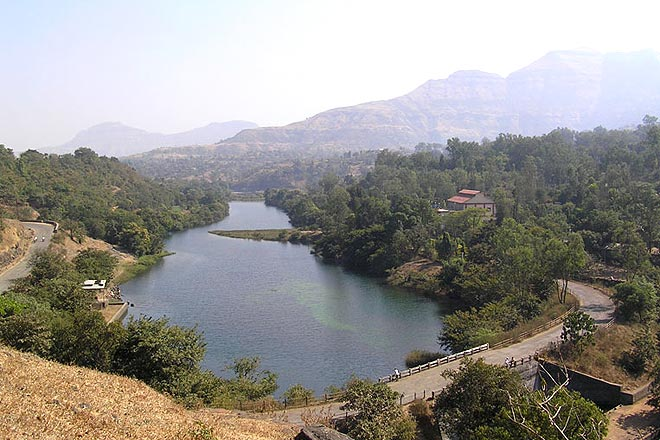 The water from the Bhandardara Dam flows through the countryside
