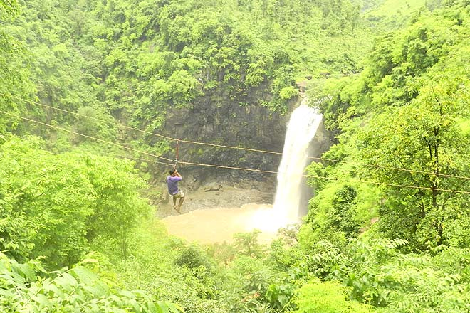 Ziplining with the Dabhosa waterfall in the background