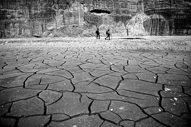 Trekkers walk along the Kali Gandaki river bed near Chuksang in upper Mustang