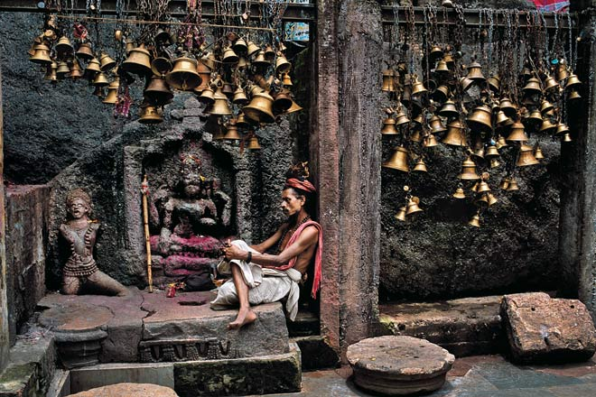 Man with many bells at Kamakhya Temple. Guwahati, Assam, 2001