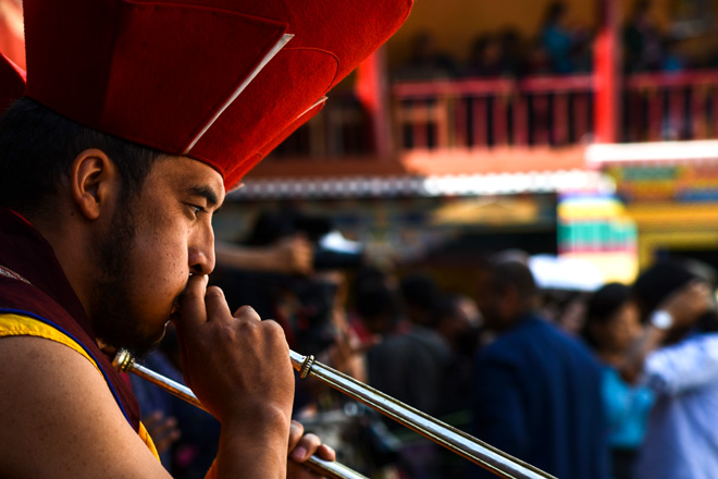 A musician plays the dughchen trumpet at the start of the Hemis Festival
