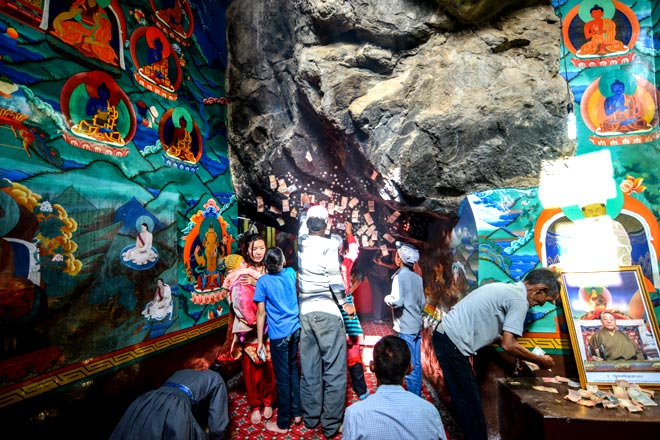 Locals pray at the cave hermitage of Kotsang