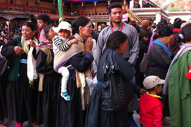 People from Hemis village line up in front of the Padmasambhava thangka to pay their respects