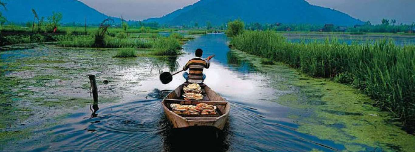 My wife and I (both in our sixties) are planning a trip to Kashmir from July 24 to August 2, ex-Delhi. 1) What are the places we must visit? 2) What are the most comfortable means of transport? 3) Could you recommend a few budget hotels? 4) Apart from the
