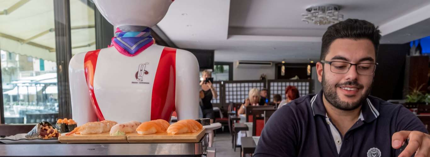 Dutch Restaurant Employs Robot Waiters to Maintain Social Distance with Diners
