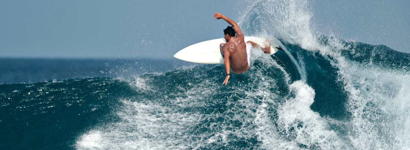 Catch the Waves at These Surfing Schools on Your Next Holiday