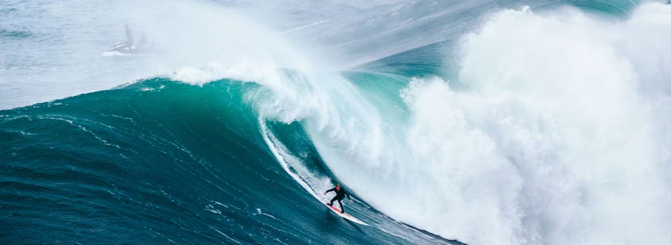 Surfers Take on Giant 65 Feet Waves in Portugal