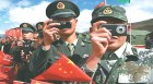 Chinese soldiers taking pictures of the Indian side during the 60th National Day celebrations at Bum La, Indo-China border.