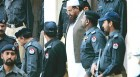 Godfather: Hafiz Saeed leaves under tight security after being produced in a Lahore court on March 9, '09