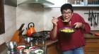 <b>Yum maro yum</b> The author in her kitchen, tucking into good ol' poha