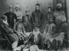 Picture taken in Benares in 1869, most probably on the occasion of his departure for London. Syed Ahmad Khan sits on the ground in the middle; standing on the left are: Syed Hamid; Chhajju; and Syed Mahmud. Seated on the chair to the right of SAK is Raja Jaikishan Das.