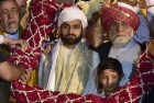Shaban Bukhari (C), the son of Delhi's Jama Masjid Shahi Imam Syed Ahmed Bukhari (R) after being formally anointed the Naib Imam of the 17th century mosque at a ceremony in New Delhi.