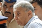 <b>Cover Artist</b> Peter Mukerjea at Mumbai's Esplanade court. The CBI now says he knew all along of the murder and kept it under wraps.