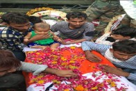 Martyr's Infant Child Sits On His Coffin, Making Everyone Emotional