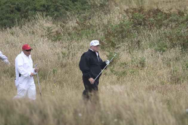 Donald Trump golfs as thousands in Scotland protest his UK visit