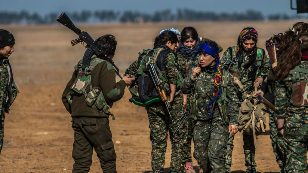 Kurdish female fighters of the YPG carry their weapons as they prepare for a battle against Islamic State fighters near the village of Mabrouka, northeast Syria: AP