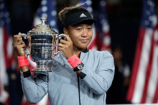 Naomi Osaka, of Japan, holds the US Open trophy after defeating Serena Williams in the women's final (AP Photo/Julio Cortez).