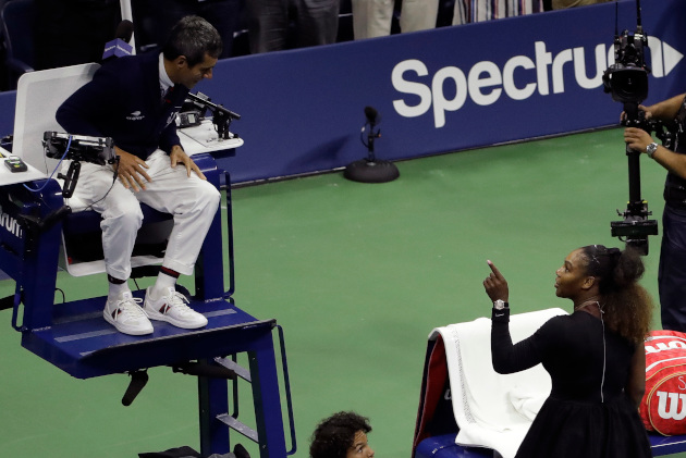 Serena Williams argues with chair umpire Carlos Ramos after being defeated by Naomi Osaka in the women's final of the US Open (AP Photo/Seth Wenig).