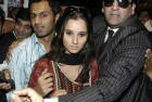 <b>Cordon sanitaire</b> Security officials surround Shoaib-Sania as they arrive at a Lahore hotel