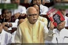 The BJP's L.K. Advani with the Outlook issue during a discussion on 'phone-tapping' in the LS, Apr 26