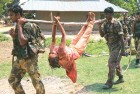 Security personnel with the body of a suspected female Maoist after the June 16 encounter in the Ranjha forests near Lalgarh