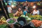 <b>Subsistence issues</b> Schoolteacher Shalu Gupta haggles with a vegetable vendor in Delhi