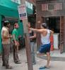 <b>Men cornered</b> It's talktime at the Wazirpur village