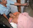 Joseph in hospital with severed limb