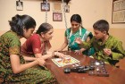 <b>Never a dull moment:</b> Sujata Vijaya (in green) pores over a game of Adu Puli Atam with her family in their Chennai home