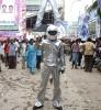 <b>Fire-Proof?</B> A Chennai fan matches his hero's dress code