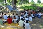 Children study in the open on the roadside in Bulandshahar, UP
