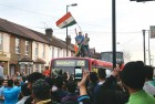 <b>Whee for victory</b> Celebrating the win atop buses in Southall