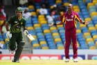 <b>Before Empty Rows</b> Mohammed Hafiz, Dwayne Bravo at Kensington Oval, Bridgetown, during the recent W. Indies-Pakistan ODI series
