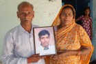 <b>Justice Unserved</b> Gulab Chand Ahirwal and his wife pose with a photo of Bal Mukund